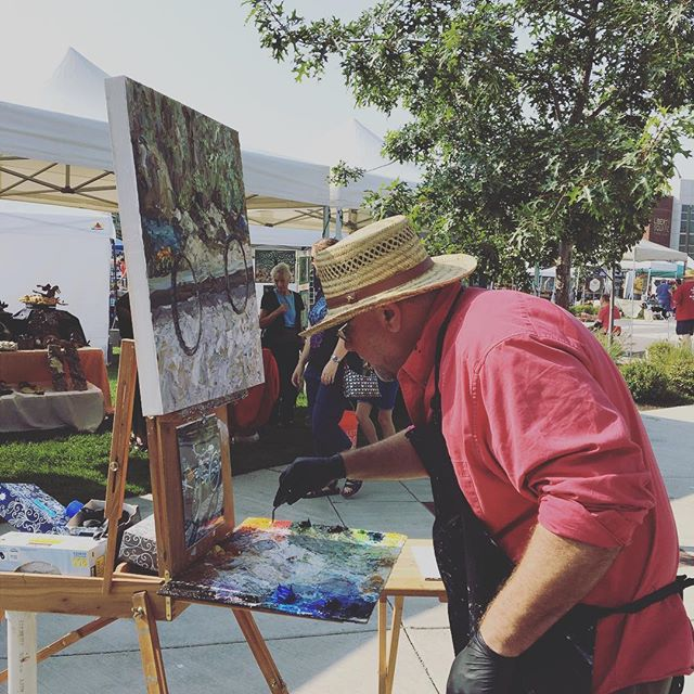 Arlon Rosenoff palette knife impressionist hard at work today at liberty lake farmers market today#artistic #art#artistsofinstagram