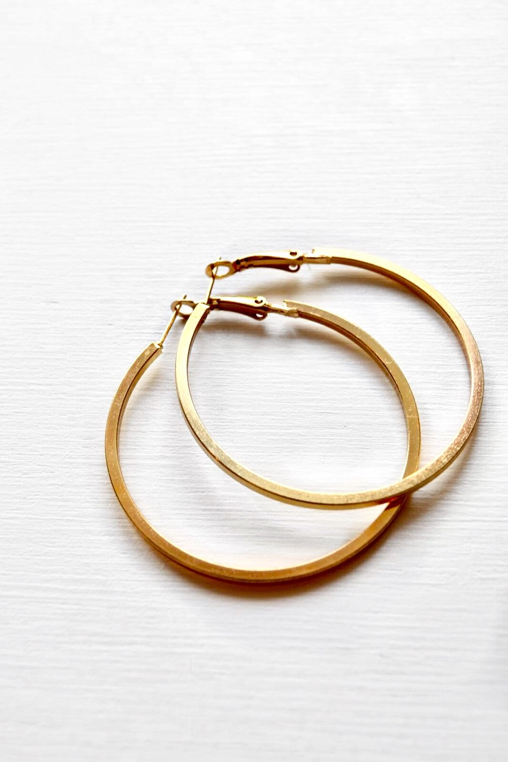 - And this wouldn't be a blogpost about jewelry, if it didn't include hoops. Hoops are probably the most staple and worn kinds of earrings ever. They're are classics.