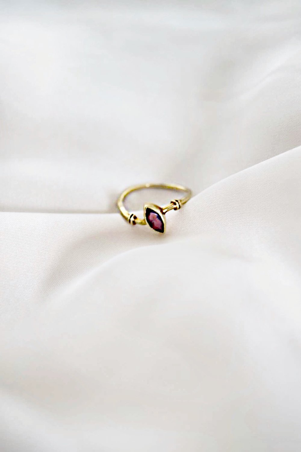 - When my great grandma died, one of the things she left behind was this cute little ring. According to my grandma it is real gold and the little stone is a real ruby. It is a sentimental piece, that I don't want to miss. And even though it's slightly bent, it's still and always will be perfect for me.