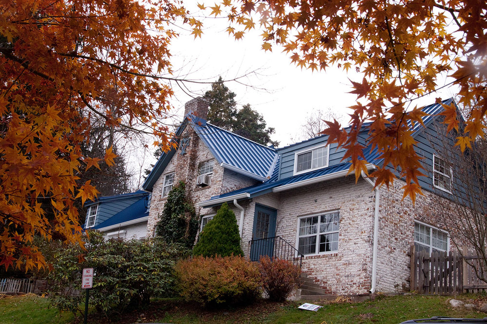 Blue roof building in fall.jpg