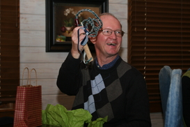 2012 President John Lomax laughs at gift for board meetings
