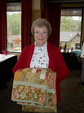 Laura Walker won the quilt raffle