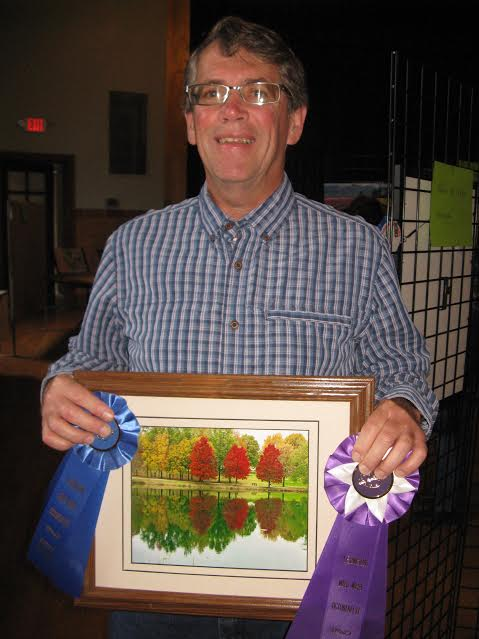 Warren Calvert, winner of People's Choice in photography with Autumn on Crystal Lake. The picture also received 1st place in Scenes of Lexington photography category.