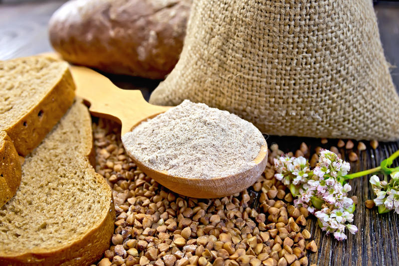 flour-buckwheat-spoon-cereals-bread-board-wooden-bag-table-slices-flower-background-wooden-70641835.jpg