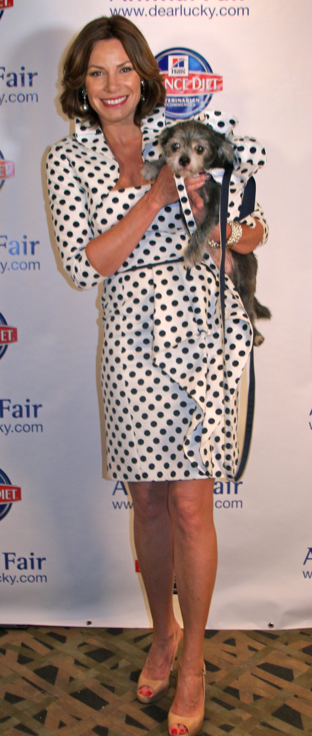 In a Teri Jon design, New York Housewife Countess LuAnn de Lesseps with Toby, adopted at the event.jpg