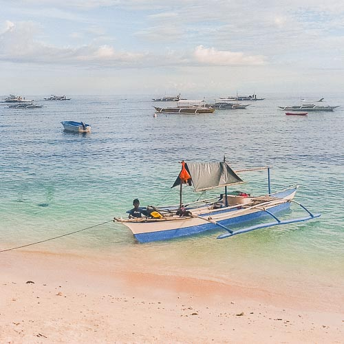 alona beach on panglao adventure in bohol island | philippines travel guide by LaidBackTrip