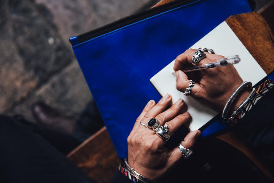 man-with-rings-writing_925x.jpg