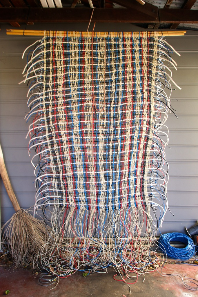 TITLE:  Unfinished business  MEDIUM: Electrical wire weaving DIMENSIONS: H280 x W150cm