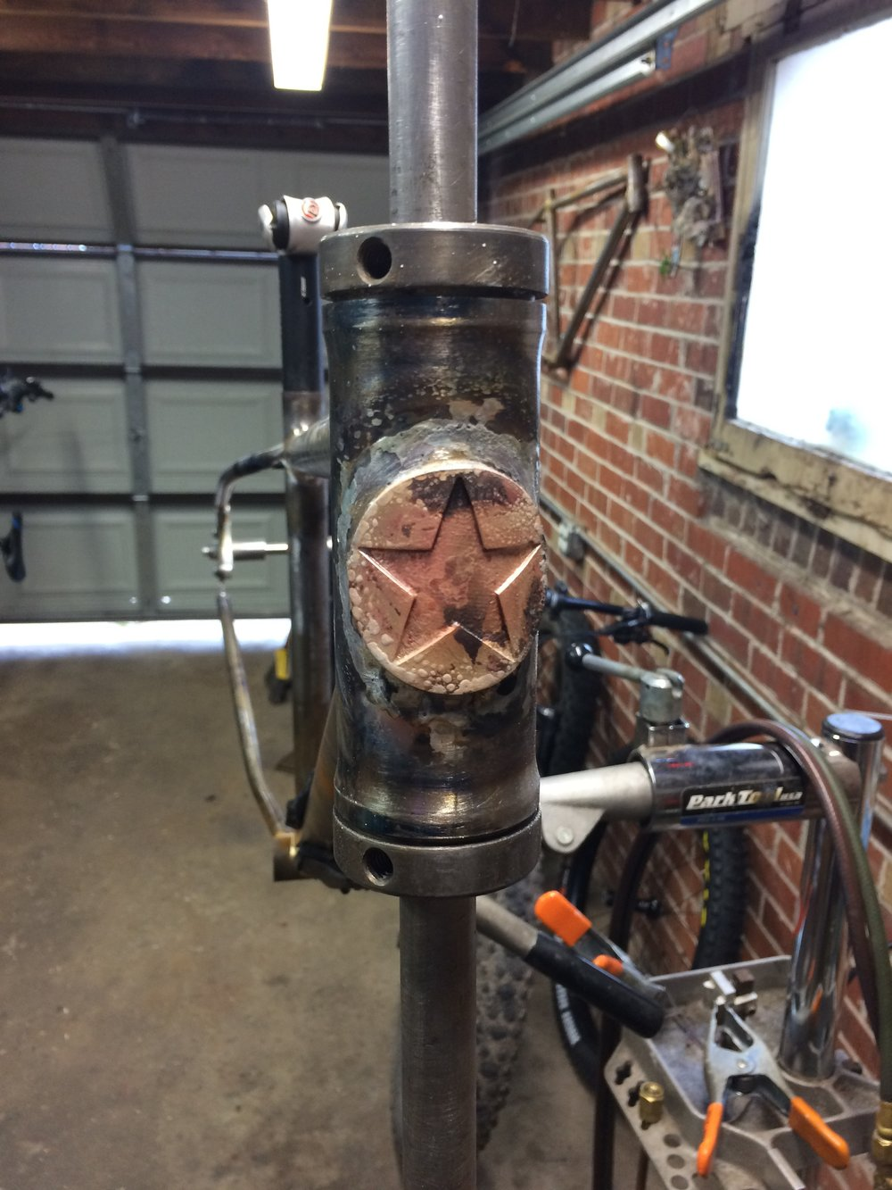 Freshly-brazed head tube badge