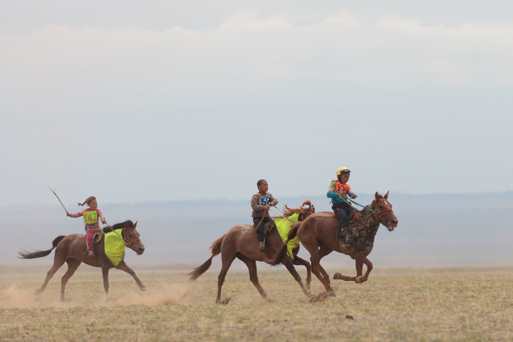 At a Gobi desert Naadam I spotted a girl Jockey. Not yet a common sight.