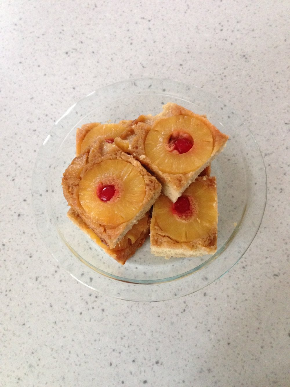 Pineapple Upside Down Cake (served on cake stand) | Cassia & Co.