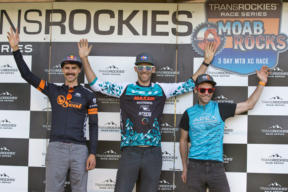 The Open Men's overall podium at 2018 Moab Rocks from left: Payson McElveen/ Orange Seal (2nd), Geoff Kabush/Yeti (1st) and Justin Lindine/Apex (3rd).