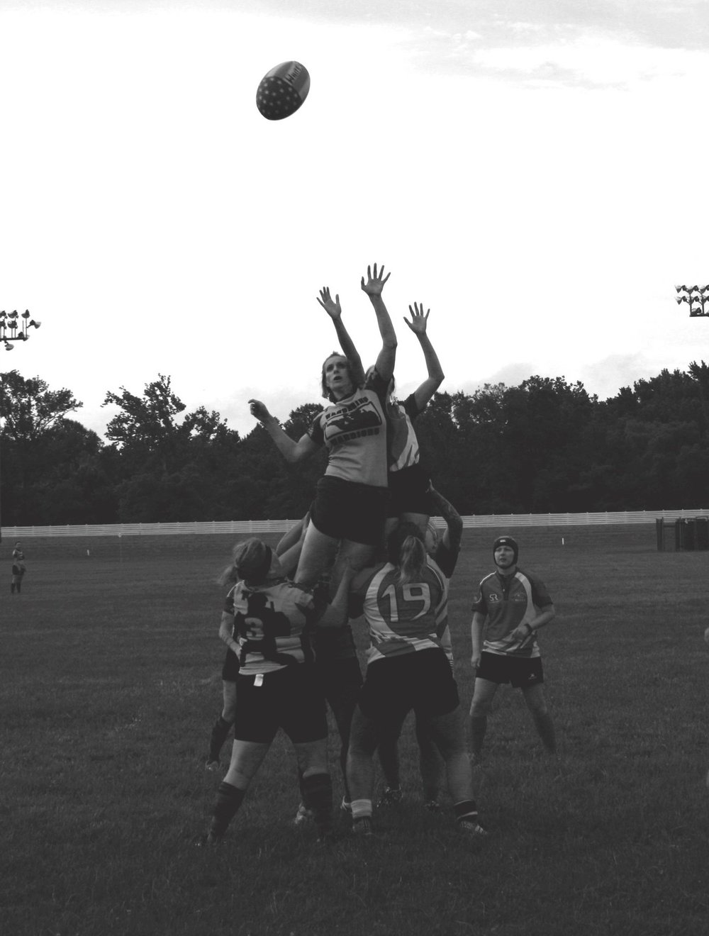 Photo Credit - Alley Mitchell  Wandering Warrior Lindsay Hagerman Jumps for a ball against Bragg Women's RFC Honor Cup 2018 - Rosecroft Raceway