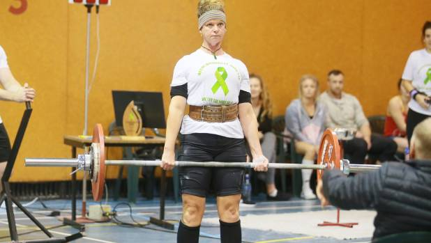 Fire Investigator Jess Johnson dead lifts during the event raising money for Starship Hospital's research into mitochondrial disease.