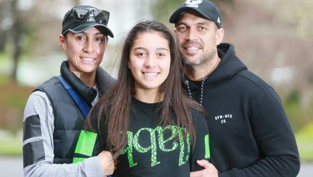 Temira Hetherington and Tai Mataroa with daughter Paris were in Hamilton to support the power-lifting event at Waikato University in support of families with children diagnosed with mitochondrial disease.