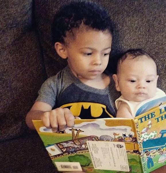 brwn boys big bro&infant couch sharing book .jpeg