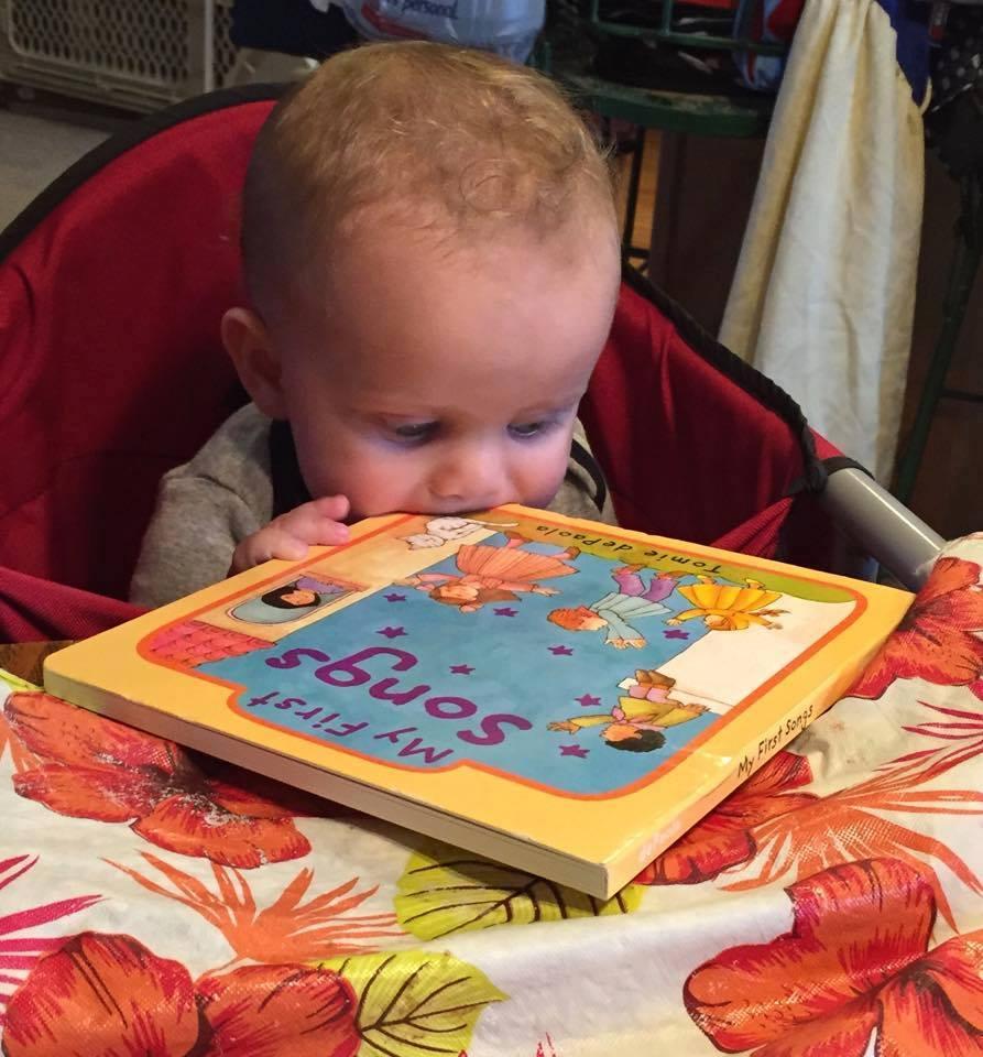 infant chewing bk white boy .jpg