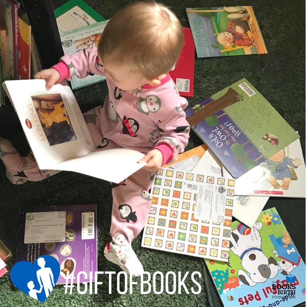 Gift of Books baby on floor books all over GBFBF.jpeg