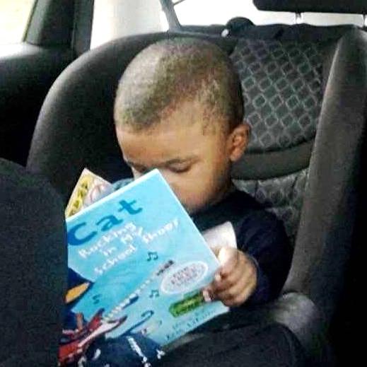 black boy car seat book in lap CROP copy.jpg
