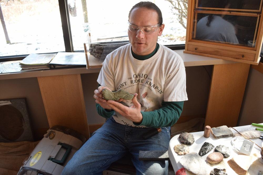 Jeremy Snyder with a preform birdstone found in Morrow County, Ohio.