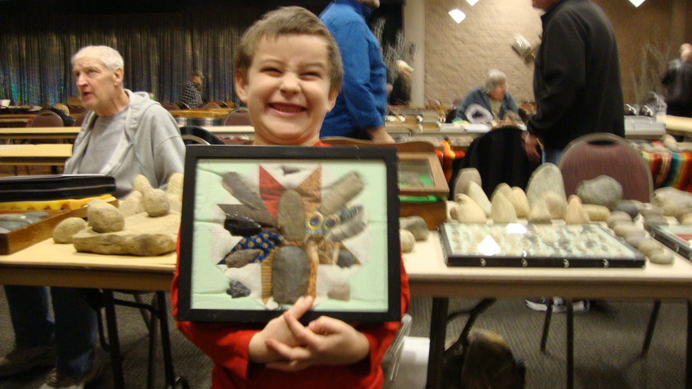 Kenton Cochran (7) with his display