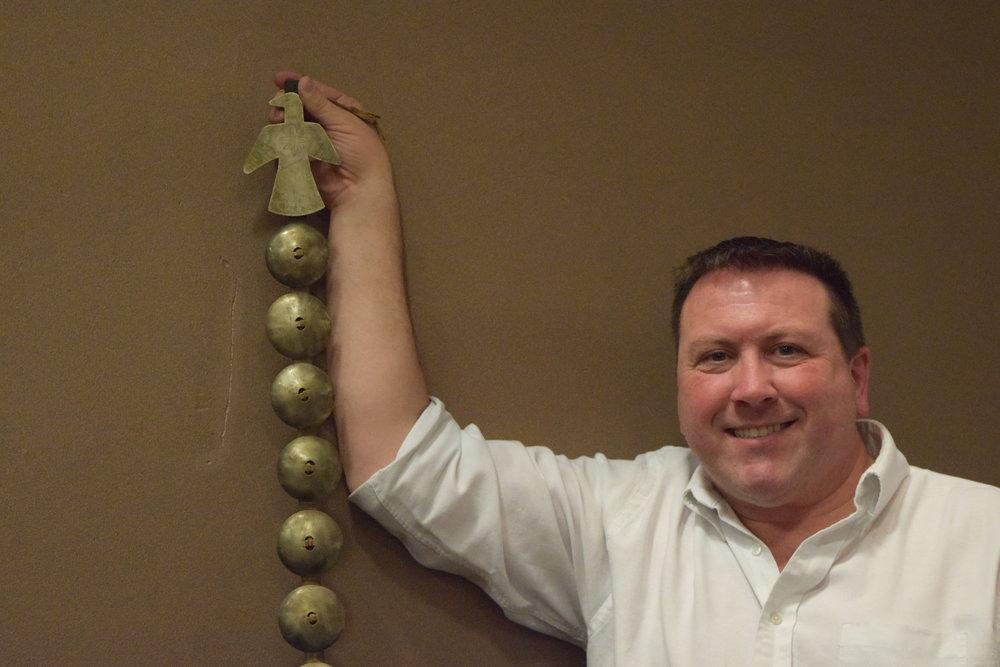 ASO President Chris Rummel holding a Headdress Concho Drop