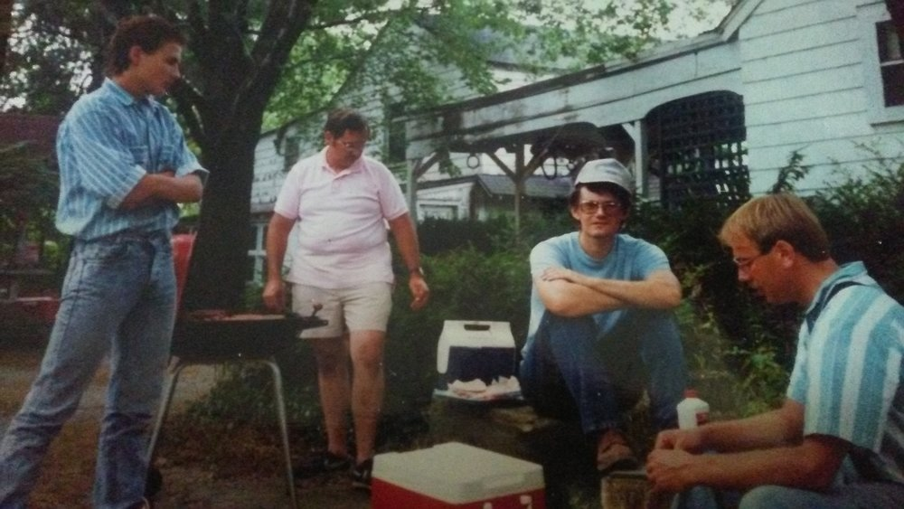 George Demuth manning the grill, with Dr. Jeb Bowen, Bill Young, and Jay Zimmerman (standing) at the Vietzen Picnic 1991