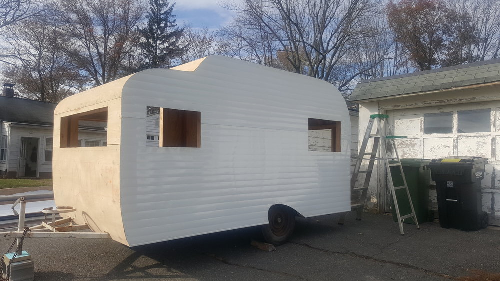 Finally starting to look like a camper again. The aluminum siding came all the way from California! That tear drop wheel well is everything. -