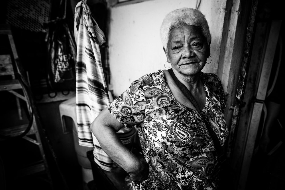 "Photo credit: Aniya Emtage Legnaro  Dona, as she's known in the Cantera community, recounts the day hurricane Maria Hit.  ""My husband held me in our bed and said, this is it. We had a good life, I love you""."