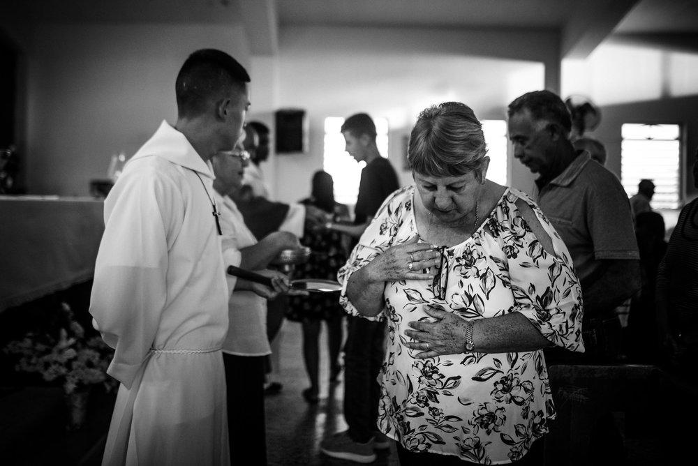 Photo credit: Aniya Emtage Legnaro  Margarita Hernandez receiving communion. Orocovis, Puerto Rico