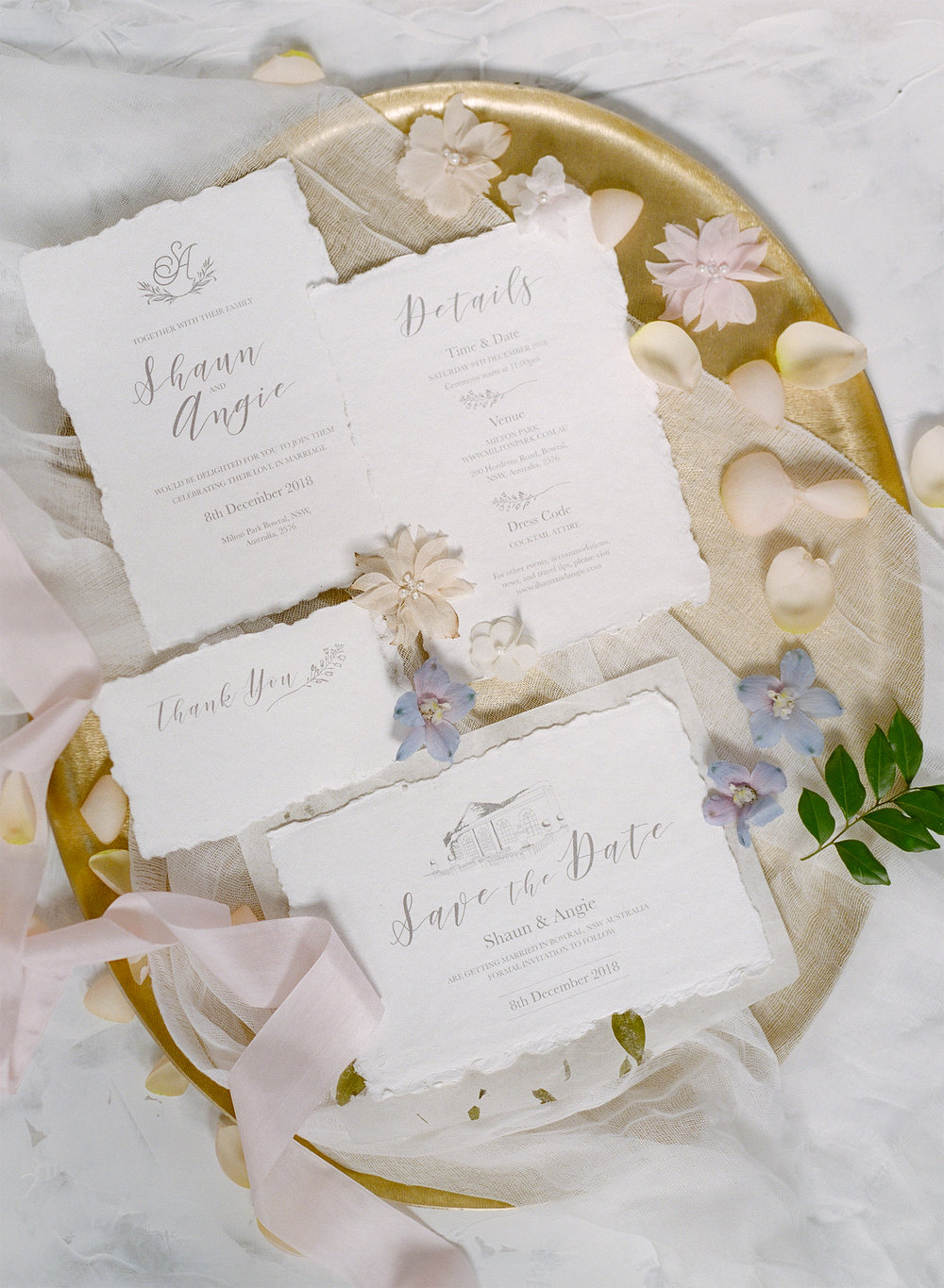 Classic White   The suit featuring handmade paper with an illustration of your wedding venue in a classic white and grey colours. You would also receive a monogram designed specially for you and your significant other half.