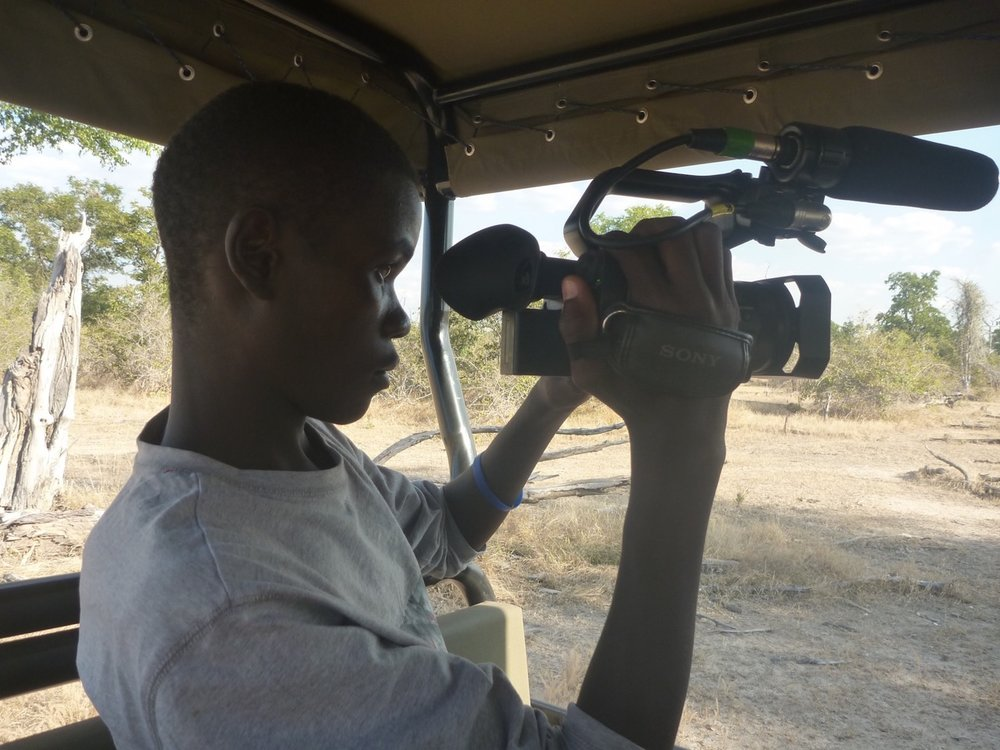 Sponsors through Africa Hope Fund gave him his first digital camera!