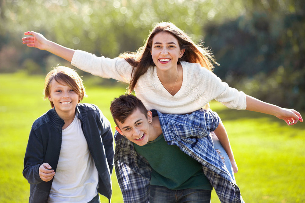 Girl-with-two-boys-posing-in-fall-park.jpg