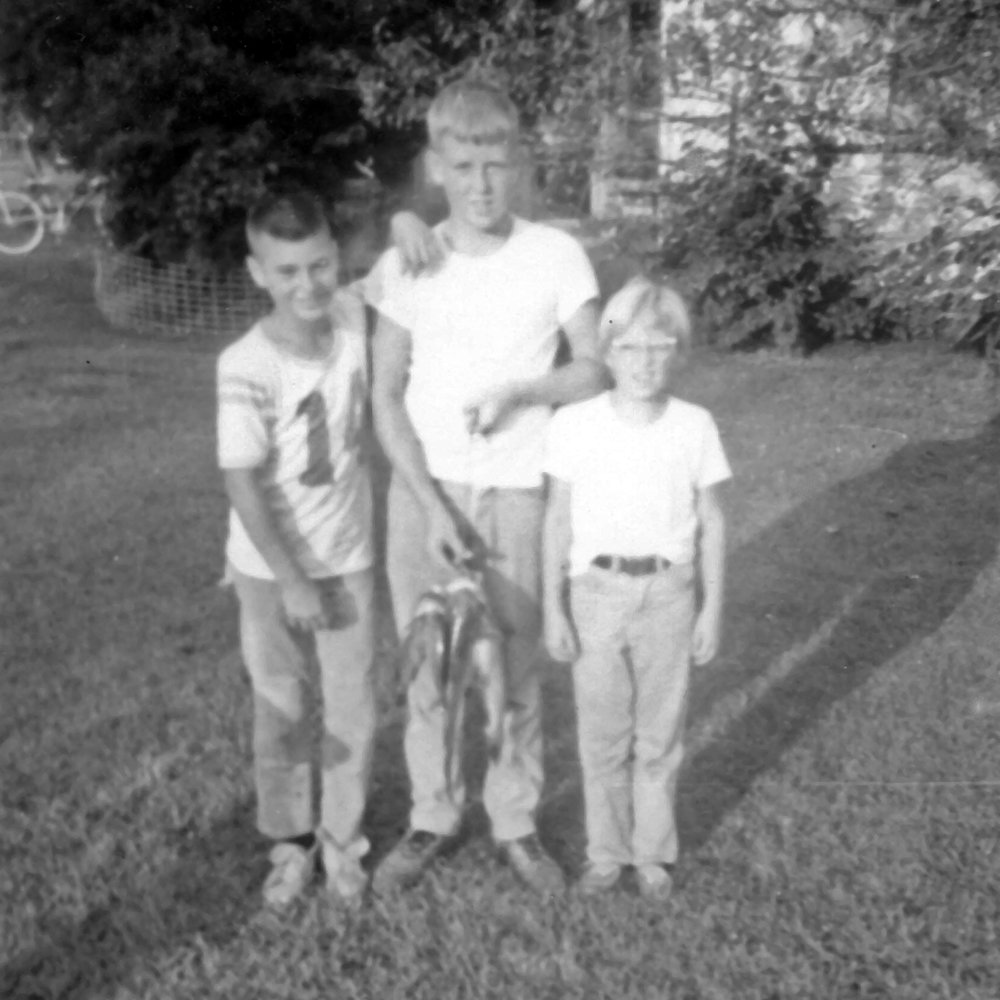 "This is the only childhood fishing photo I could find, Don. It's not very clear, but it was shot more than 50 years ago with a Brownie camera. It shows me (center) with my cousin Louis Stadler (left) and my sister Liane with a few small catfish caught from an uncle's farm pond. Might be where I got a start on the nickname ""Catfish."" I'd say it's circa 1966 when I was about 10 years old."