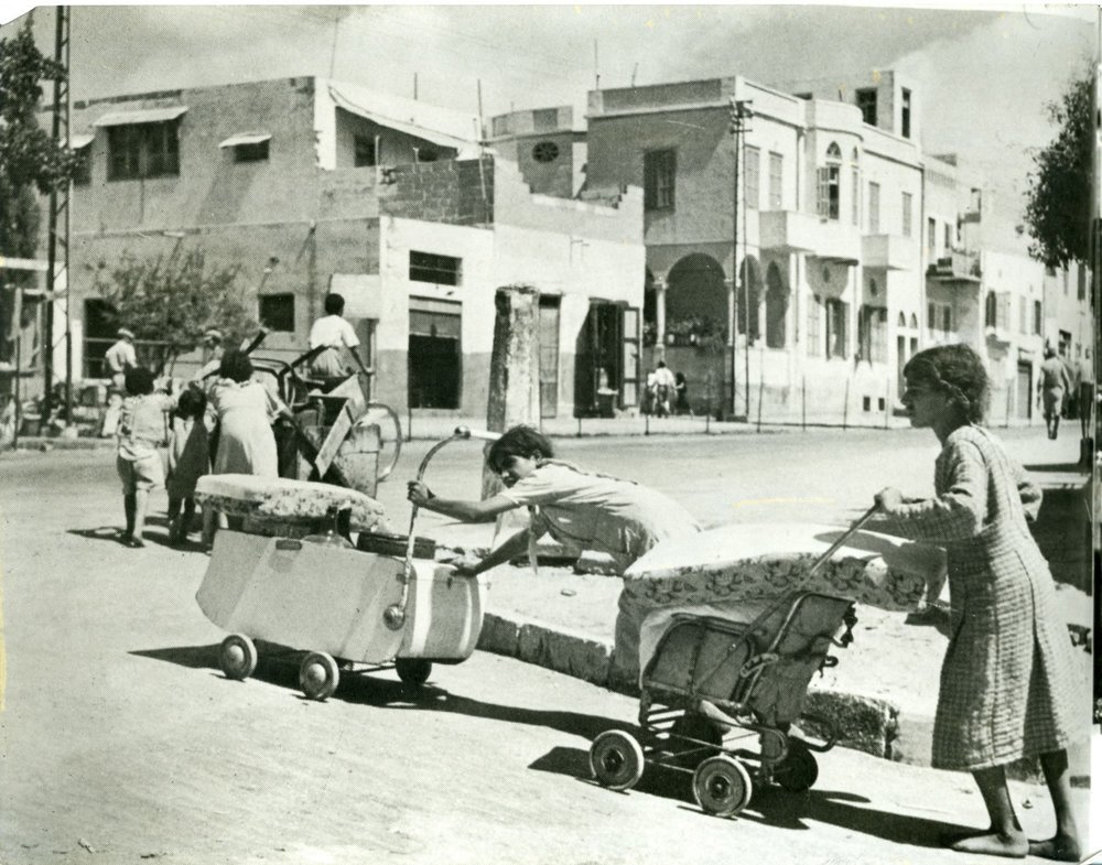 Palestinians fleeing Jaffa with their belongings, 1948.  [1]