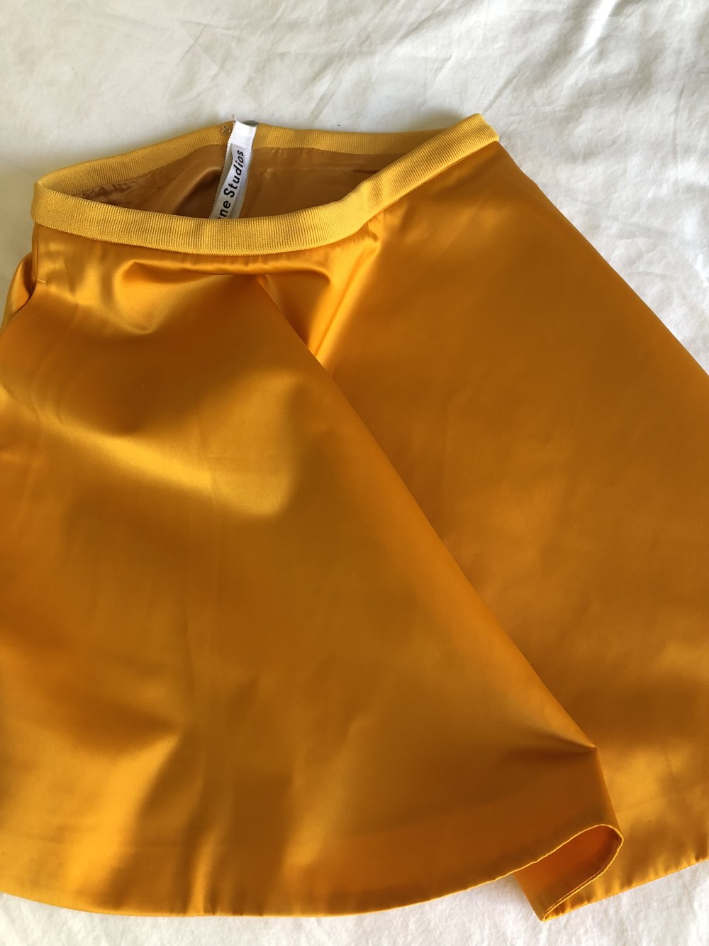 FRESHLY SQUEEZED IN OUR STOCKROOM: THIS PRE-OWNED ACNE STUDIOS SKIRT IS JUST WAITING TO BE YOURS FOR A MONTH!