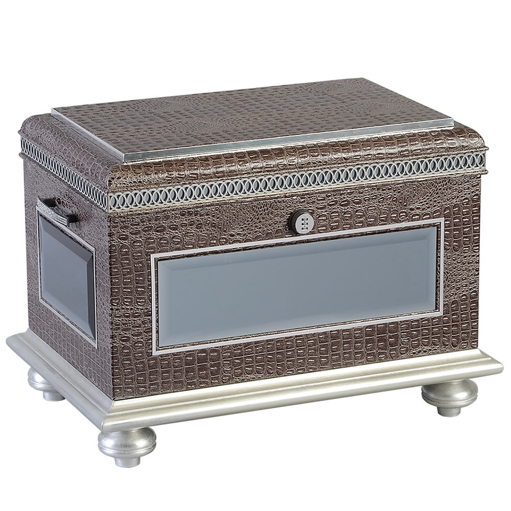 "The Aristocrat Life Chest™  - Exotic silver-grey faux reptile skin finish with silver paint strips, mirror detail and crystal-lined handles.The Aristocrat's interior features velvet-lined trays, one horizontal divider, two vertical dividers, a marble floor and a mounted photo frame.Dimensions: 24"" W x 15.5"" D x 19.5"" HWeight : 65 lbs"