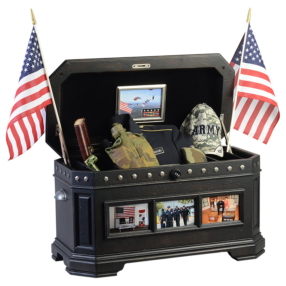"The Freedom Life Chest™ - Collaboratively designed with the U. S. Special Forces, this handsome distressed Freedom Life Chest with charcoal finish has a unique story.Completely customizable with its six 4x6 exterior frames, one 5x7 interior frame, and pewter emblems representing each branch of the U. S. Armed Forces (Army, Air Force, Navy, Marines, Coast Guard) as well as the Great Seal of the United States.  For every Hometown Hero.Dimensions: 31"" W x 15.5"" D x 17"" HWeight : 54 lbs."