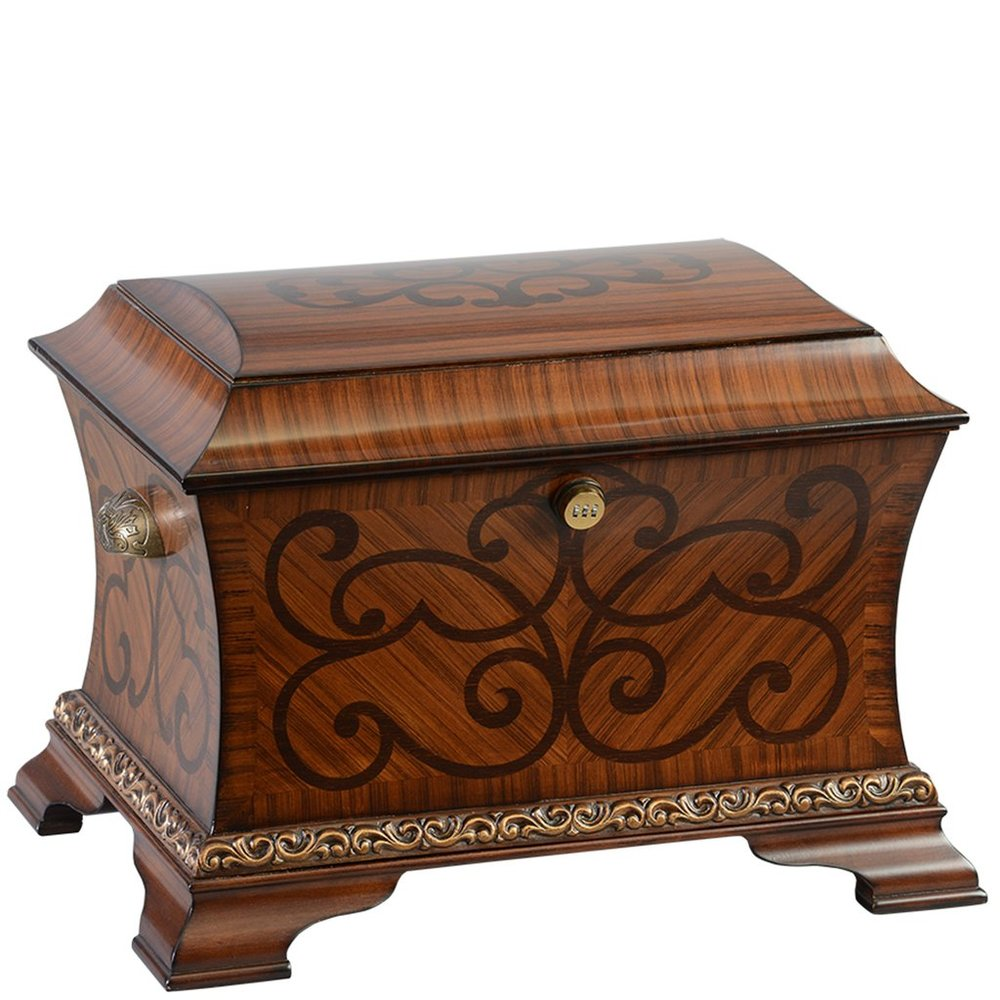 "The Legacy Life Chest™ - With its multiple curved inlay design, the Legacy is the definition of refined. A warm honey finish is complimented by a beautiful carved motif at the base.The spacious interior includes soft espresso-toned velvet, sectioned tray, one vertical divider, one horizontal divider, a veined marble floor and mounted gold photo frame.Dimensions: 25"" W x 17"" D x 17.5"" HWeight : 51 lbs."