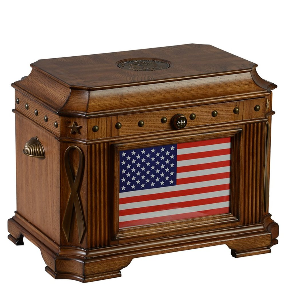 The Patriot Life Chest™ - Warm oak finish with antique brass, carved details, American flag front, and 5