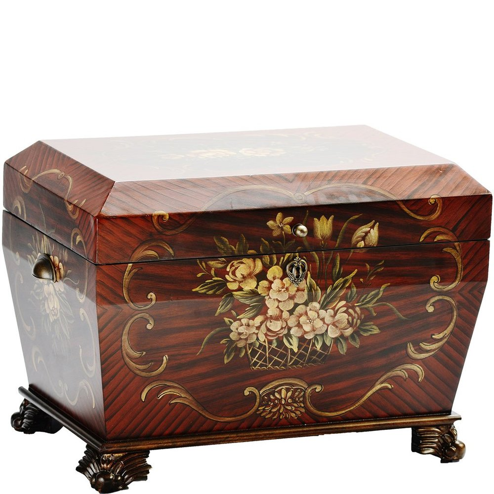 "The Prague Life Chest™ - In deep cherry and rosewood tones appearing in a subtle elongated diamond pattern, the Prague showcases a lovely hand-painted basket and flower design. It rests on antique bronze claw feet with bronze detailing on all sides.The lush velvet lining covers a removable divided tray that sits atop the three vertical, interior dividers of the chest creating four compartments within the Prague. Perfect for keeping vestiges of days gone by and tokens of memories yet to be made, the Prague is a Life Chest that will be truly treasured.Dimensions: 24"" W x 16"" D x 17.5"" HWeight: 38 lbs."
