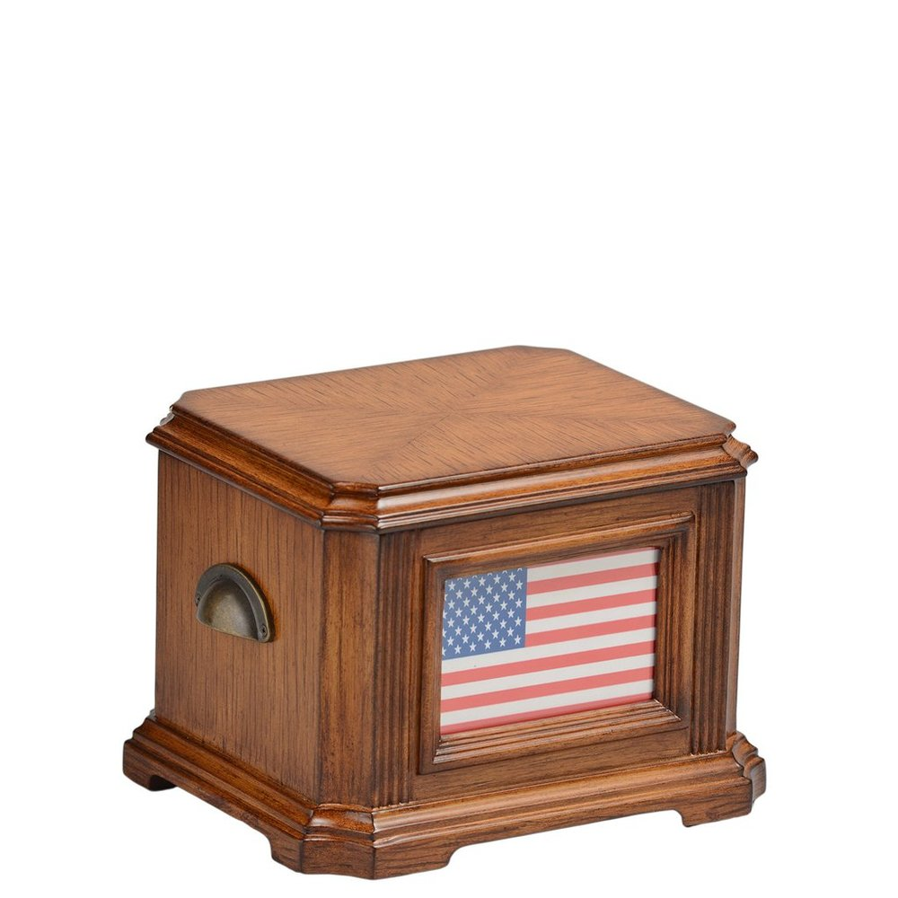 Patriot Memory Life Chest™ - Warm oak finish with antique brass, carved details, American flag front, and velvet-lined interior.Dimensions: 10.5″ W x 9″ D x 6.25″ HWeight : 7 lbs.