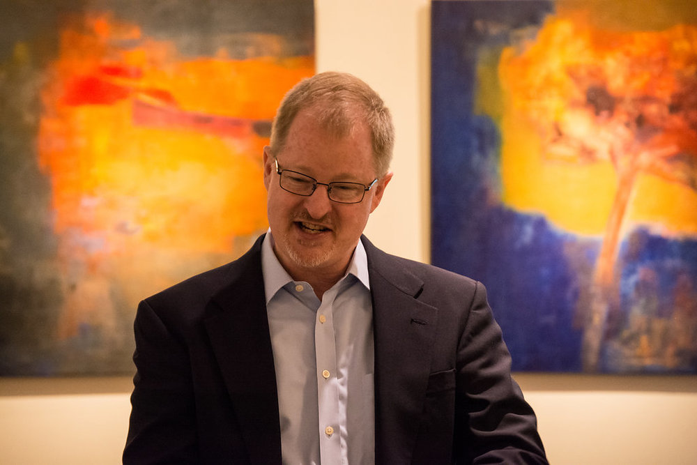 Man in front of Painting.jpg