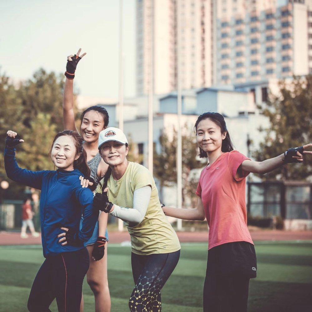 Susan Zeng (in green) at Jiao Tong University, Shanghai, China (Photo Credit: Charles Qin)