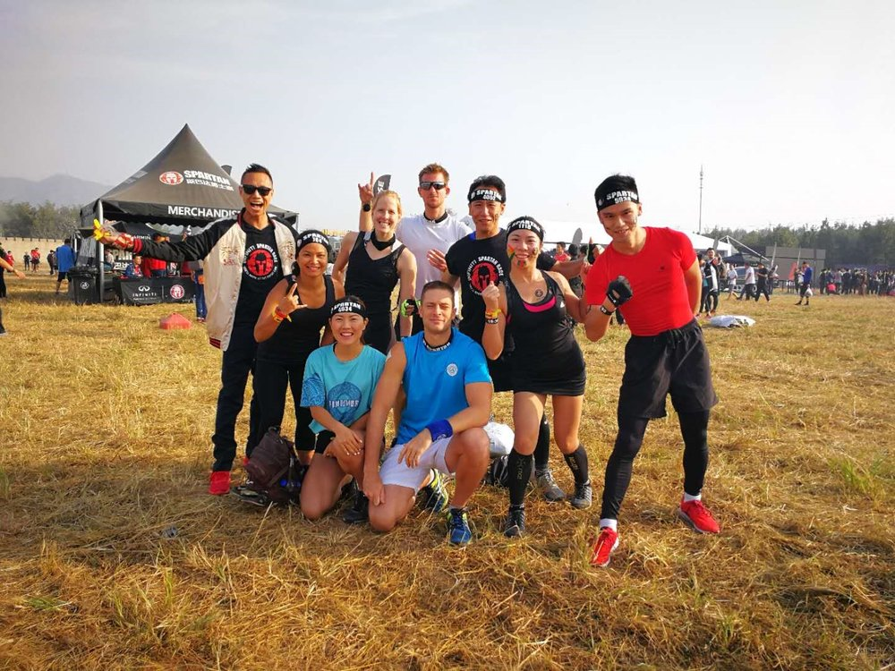 FitFam team and I (in red) at a Spartan race.