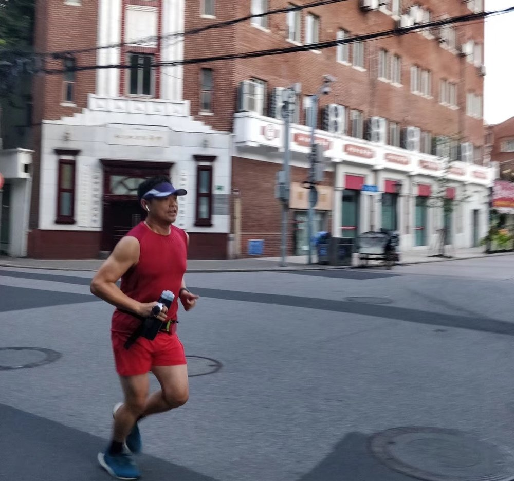 Steven running on empty streets in Shanghai at 6:00 AM
