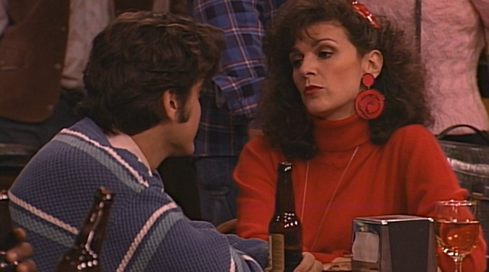 Meanwhile, across the Lobo, Janine is about to buy what Booker is selling. We love Janine's severe look with the giant earrings, red lips, and big plastic barrette.