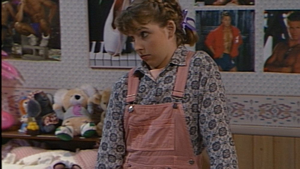 Becky looks darling with her braids and pink jumper.