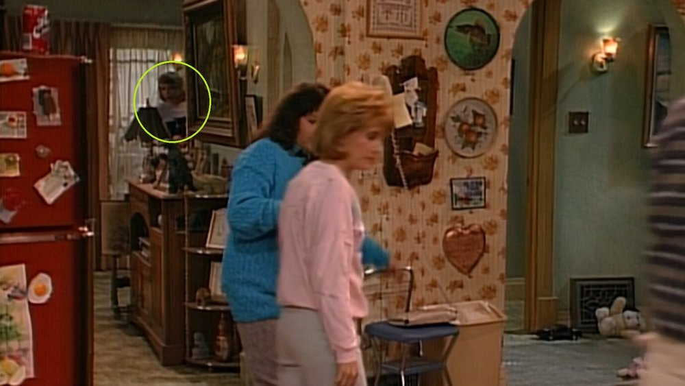 She doesn't go offstage upstairs, though, and instead peeks back into the kitchen at Roseanne and Natalie.