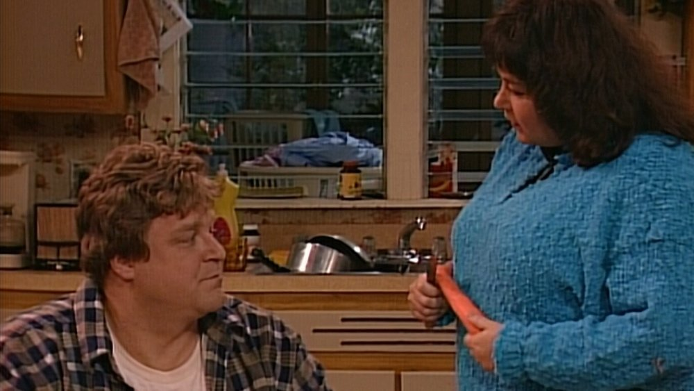 Roseanne gingerly Bobbits her carrot.